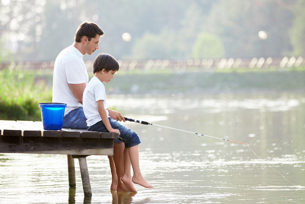 Man and boy fishing on the lake; Shutterstock ID 85363498; PO: aol; Job: production; Client: drone